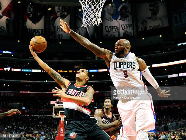 Shabazz Napier of the Portland Trail Blazers goes up for a layup against Marreese Speights of the Los Angeles Clippers during the second half of...