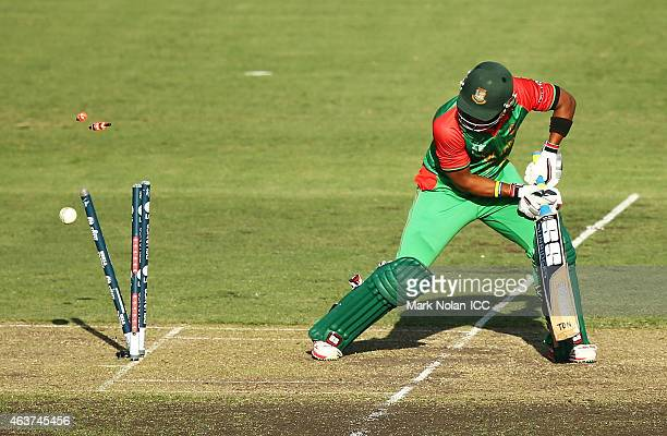 Shabbir Rahman of Bangladesh is bowled by Hamid Hassan of Afghanistan during the 2015 ICC Cricket World Cup match between Bangladesh and Afghanistan...