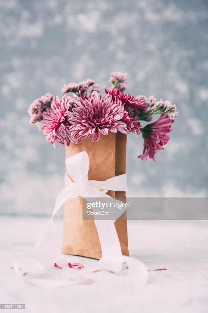 Shabby Chic Flowers In Paper Bag Over Vintage Background Mothers Day Or Wedding Concept
