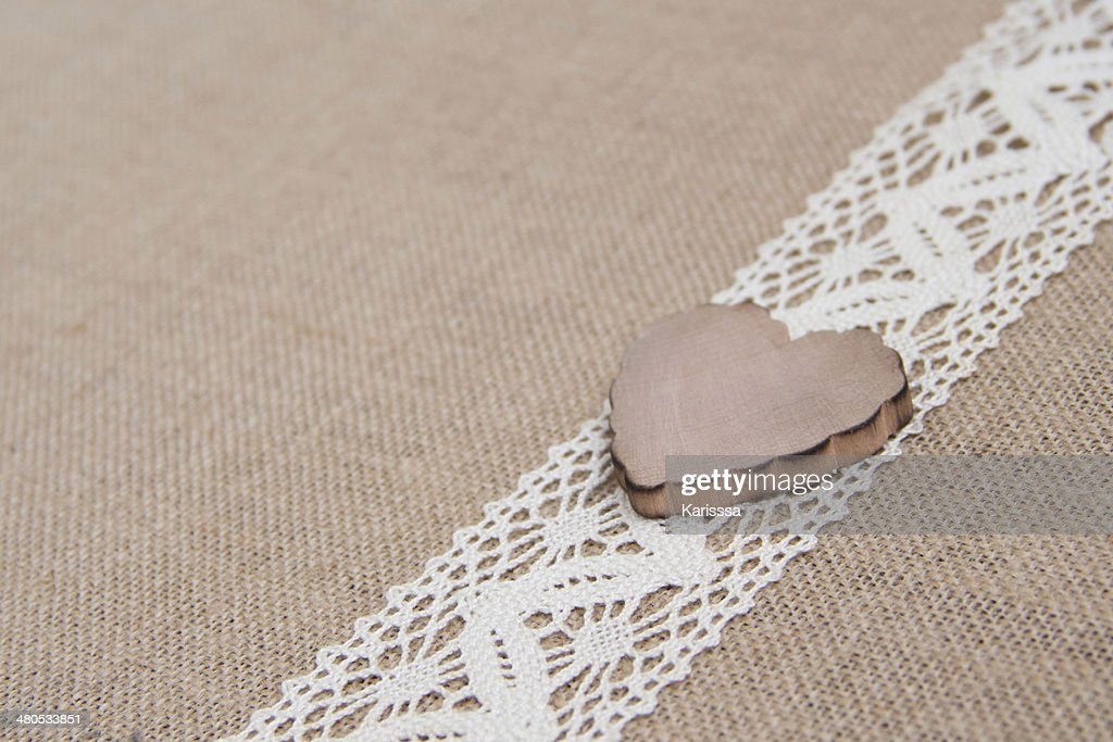 Shabby rustic background with wooden heart : Stock Photo
