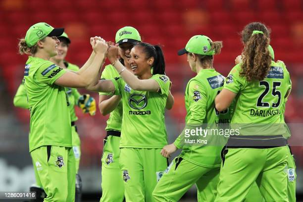 Shabnim Ismail of the Thunder celebrates with team mates after taking the wicket of Lizelle Lee of the Renegades during the Women's Big Bash League...