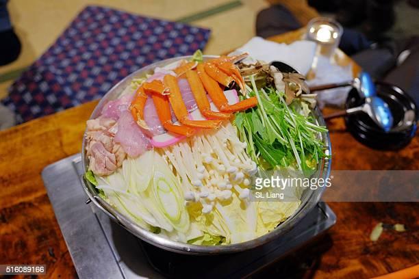 Shabu-shabu vegetables, traditional Japanese ingredients including enoki mushrooms, shiitake mushroo