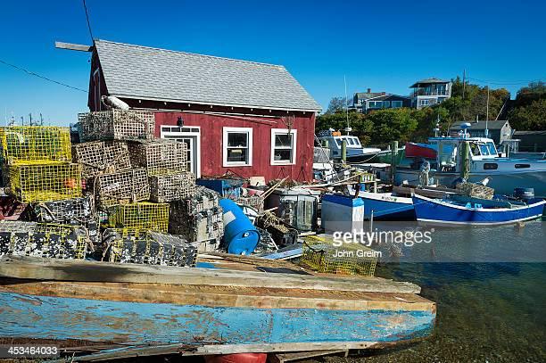S VINEYARD MENEMSHA MASSACHUSETTS UNITED STATES Shack lobster traps and boats in fishing village