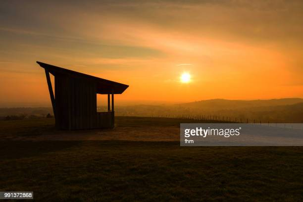 a shack on a viewpoint in the black forest in germany on the beach in a colorful sunset (baden-württemberg, germany) - baden württemberg foto e immagini stock