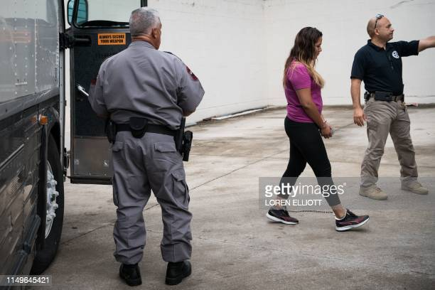 Shackled migrant woman in federal custody arrives for an immigration hearing at the US federal courthouse on June 12 in McAllen, Texas.