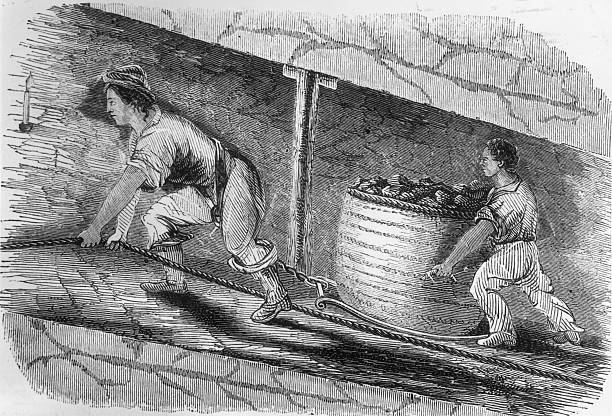 A shackled woman and child dragging a container of...