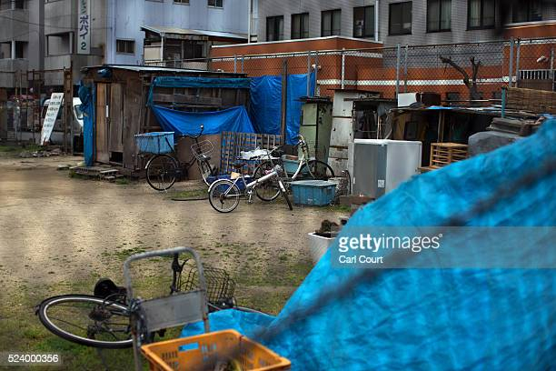 Shacks are pictured in the slum area of Kamagasaki on April 23 2016 in Osaka Japan Kamagasaki a district in Japan's second largest city Osaka is home...