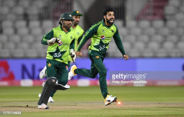 Shadab Khan and Sarfaraz Ahmed of Pakistan celebrate after the run out of Eoin Morgan of England during the 3rd Vitality Twenty20 match at Emirates...