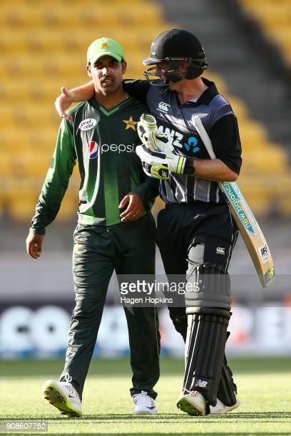 Shadab Khan of Pakistan and Colin Munro of New Zealand leave the field at the end of play during game one of the Twenty20 series between New Zealand...