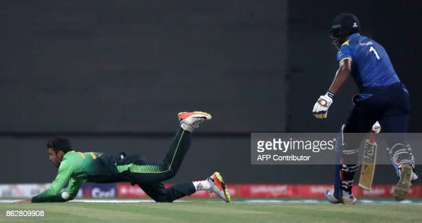 Shadab Khan of Pakistan bowls during the third one day international match between Pakistan and Sri Lanka in Abu Dhabi at Zayed Cricket Stadium on...