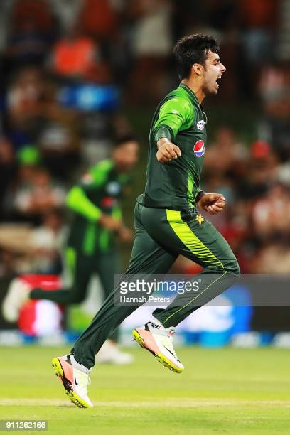Shadab Khan of Pakistan celebrates after claiming the wicket of Martin Guptill of the Black Caps during game three of the International Twenty20...