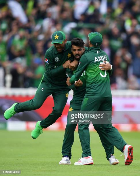 Shadab Khan of Pakistan celebrates after taking the wicket of Kane Williamson with Fakhar Zaman and Mohammad Amir of Pakistan during the Group Stage...
