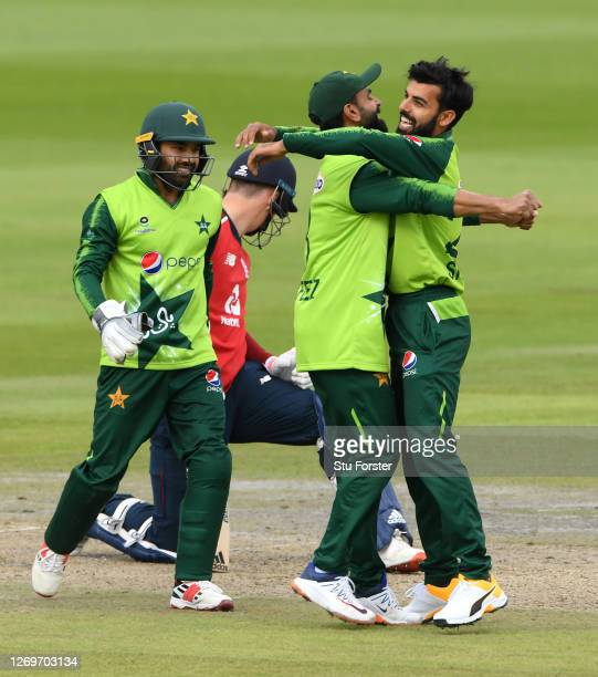 Shadab Khan of Pakistan celebrates the wicket of Tom Banton of England with Mohammad Hafeez and Mohammad Rizwan during the 2nd Vitality International...