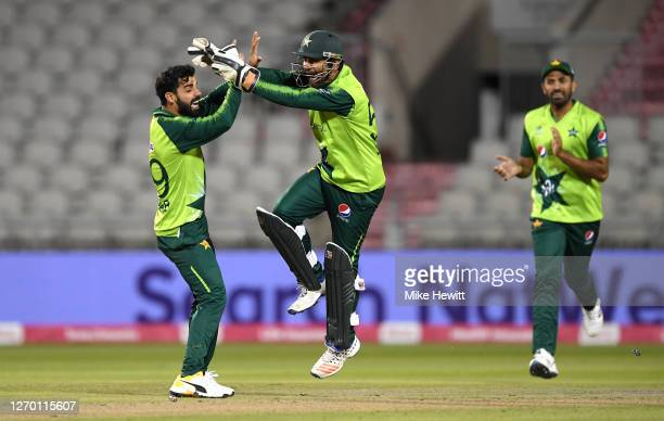 Shadab Khan of Pakistan celebrates with Sarfaraz Ahmed after the run out of Eoin Morgan of England during the 3rd Vitality International Twenty20...
