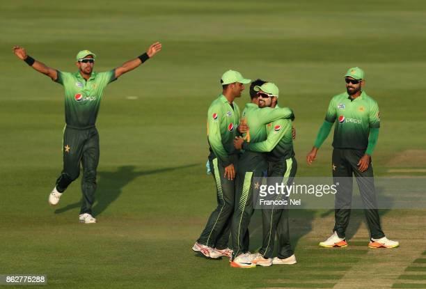 Shadab Khan of Pakistan celebrates with teammates after dismissing Upul Tharanga of Sri Lanka during the third One Day International match between...