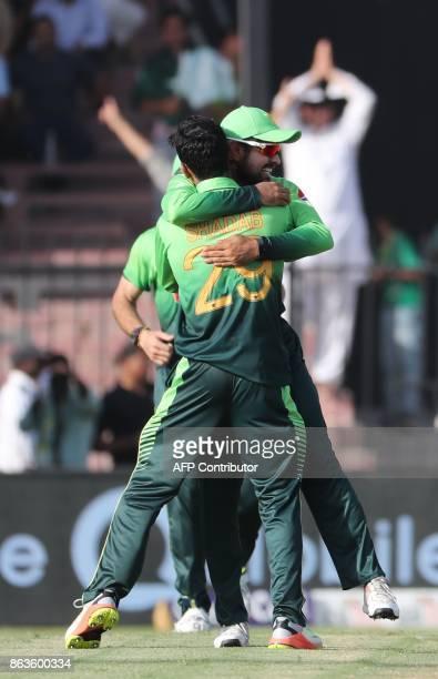 Shadab Khan of Pakistan celebrates with teammates after dismissing Sadeera Samarawickrama of Sri Lanka during the third one day international cricket...