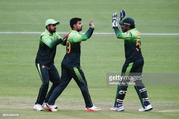 Shadab Khan of Pakistan celebrates with teammates for the wicket of Colin Munro of New Zealand during game four of the One Day International Series...