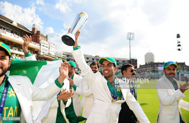 Shadab Khan of Pakistan celebrates with the trophy during the ICC Champions Trophy Final match between India and Pakistan at The Kia Oval on June 18...