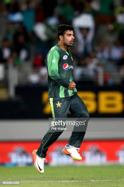 Shadab Khan of Pakistan celerbrates the wicket of Colin de Grandhomme of the Blackcaps during the International Twenty20 match between New Zealand...