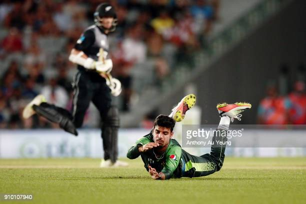 Shadab Khan of Pakistan dives for a ball during the International Twenty20 match between New Zealand and Pakistan at Eden Park on January 25 2018 in...