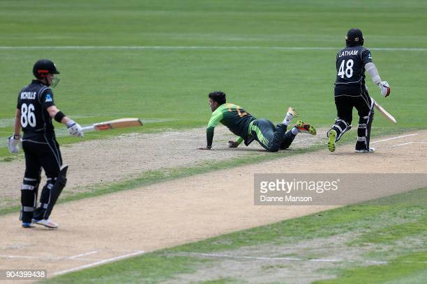 Shadab Khan of Pakistan fields off his own bowling to catch out Henry Nicholls of New Zealand during the third game of the One Day International...