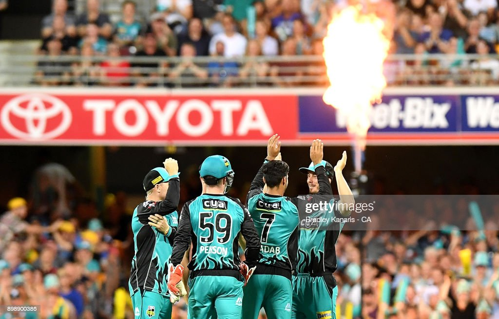 Shadab Khan of the Heat celebrates taking the wicket of Jos Butler of the Thunder during the Big Bash League match between the Brisbane Heat and the Sydney Thunder at The Gabba on December 27, 2017 in Brisbane, Australia.