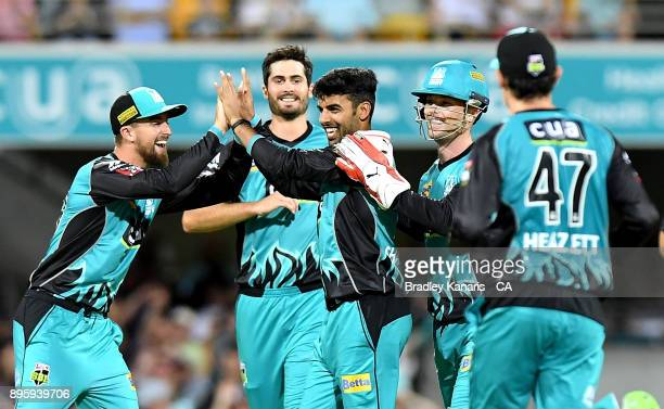 Shadab Khan of the Heat celebrates with team mates after taking a wicket during the Big Bash League match between the Brisbane Heat and the Melbourne...