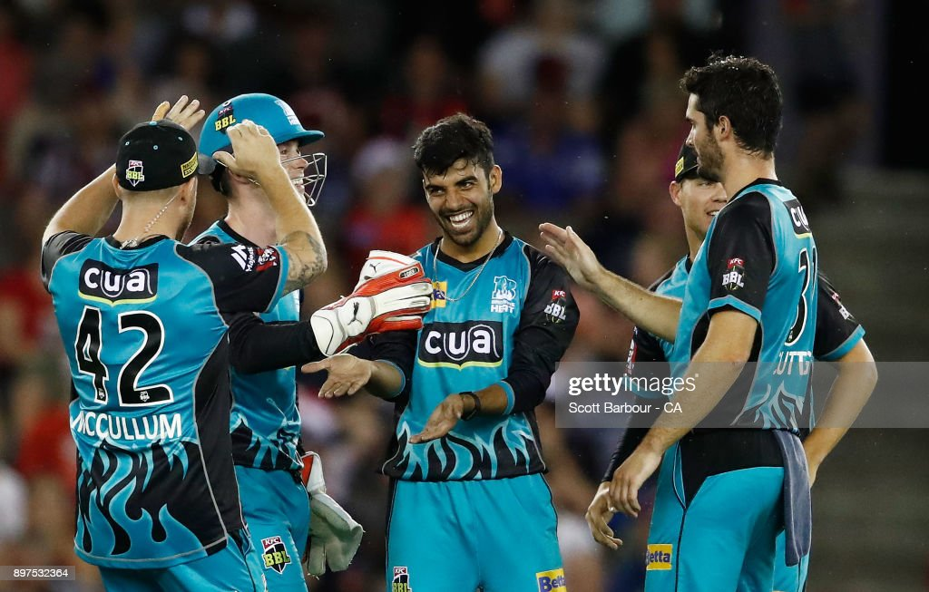 Shadab Khan of the Heat is congratulated by his teammates after dismissing Marcus Harris of the Renegades during the Big Bash League match between the Melbourne Renegades and the Brisbane Heat at Etihad Stadium on December 23, 2017 in Melbourne, Australia.