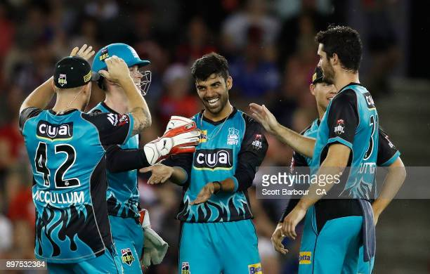 Shadab Khan of the Heat is congratulated by his teammates after dismissing Marcus Harris of the Renegades during the Big Bash League match between...