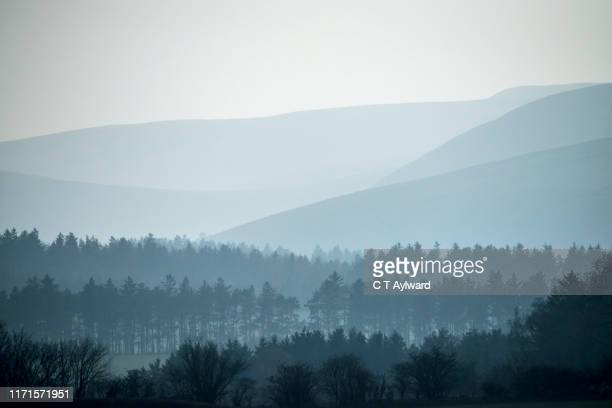 shades of blues and mountain silhouettes - valley stock pictures, royalty-free photos & images