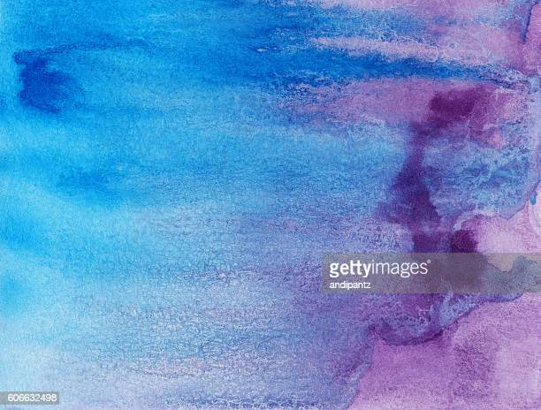 Shades of purple and blue paint in textured background