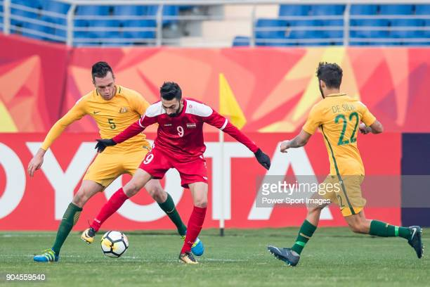 Shadi Alhamwi of Syria fights for the ball with Aleksandar Susnjar of Australia and Daniel De Silva of Australia during the AFC U23 Championship...
