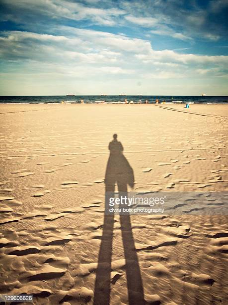 shadow at beach - castellon de la plana stock photos and pictures
