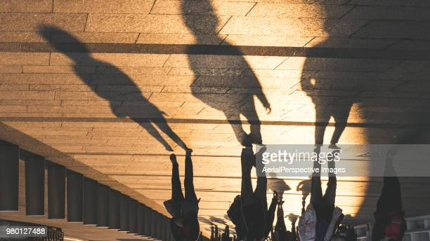shadow at sunset - pedestrian stock pictures, royalty-free photos & images