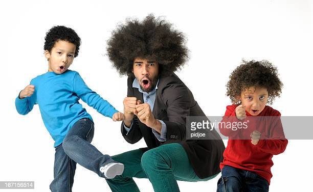 shadow boxing funky man and two little boys - funny boxing stock photos and pictures