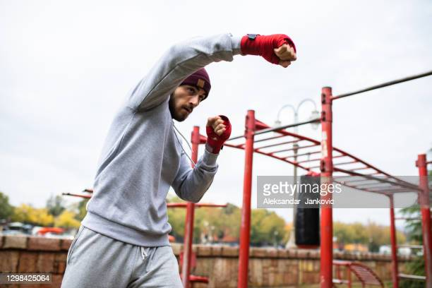 shadow boxing practice outdoors - mixed martial arts stock pictures, royalty-free photos & images
