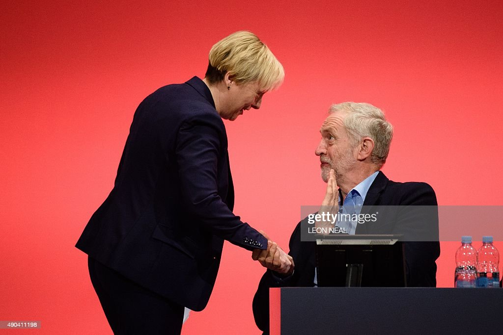 Shadow Business Secretary Angela Eagle (L) is congratulated by Labour party leader Jeremy Corbyn after her speech to delegates on day two of the annual Labour party conference in Brighton on September 28, 2015.