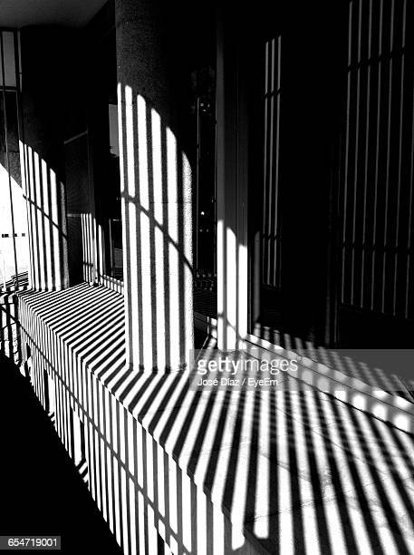 Shadow By Prison Cells During Sunny Day