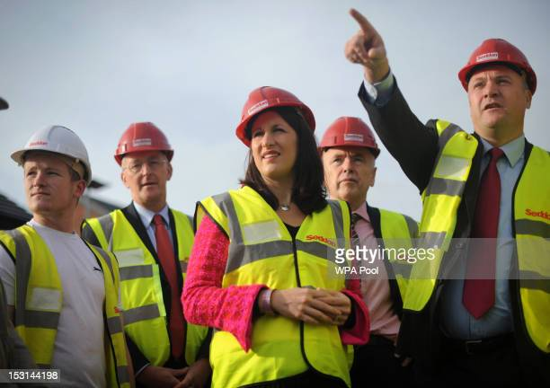 Shadow chancellor Ed Balls visits a social housing project with Labour front bench colleagues Shadow Chief Secretary to the Treasury Rachel Reeves...