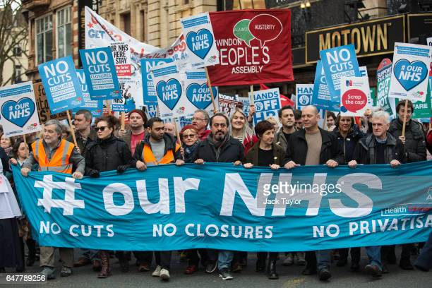 Shadow Chancellor John McDonnell and actress Julie Hesmondhalgh join protesters as they carry banners and placards through central London during a...