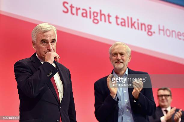Shadow chancellor John McDonnell and Jeremy Corbyn take applause after addressing the Labour Party autumn conference on September 28 2015 in...