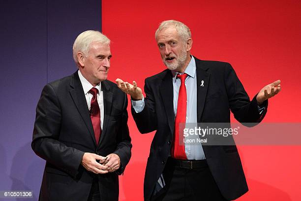 Shadow Chancellor John McDonnell is congratulated by the Labour Party leader Jeremy Corbyn following his keynote speech on the second day of the...