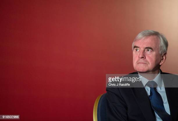 Shadow Chancellor John McDonnell sits on a panel after speaking to an audience at a Labour Party conference on alternative models of ownership on...