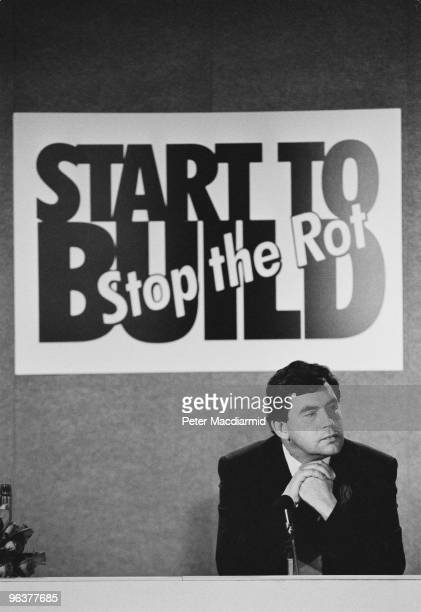 Shadow Chancellor of the Exchequer Gordon Brown at a press conference on tax in London September 1993 The poster behind him reads 'Start to Build...