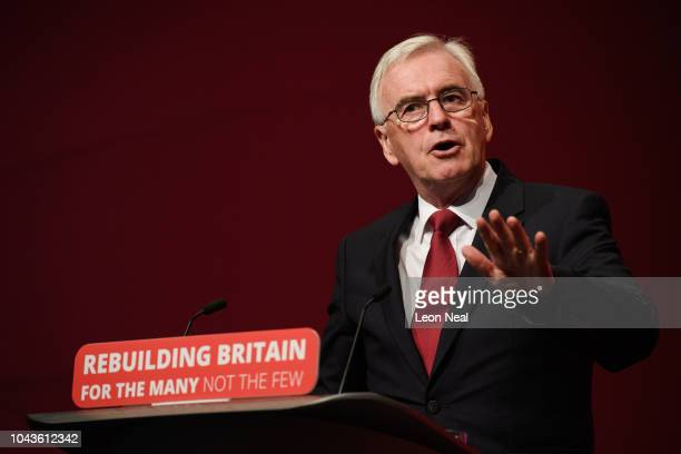 Shadow Chancellor of the Exchequer John McDonnell addresses delegates in the Exhibition Centre Liverpool during day two of the annual Labour Party...