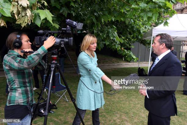Shadow Defence secretary Dr Liam Fox is interviewed by PA staff Ellie Price and Charlotte McCathie on Abingdon Green near the House of Commons in...