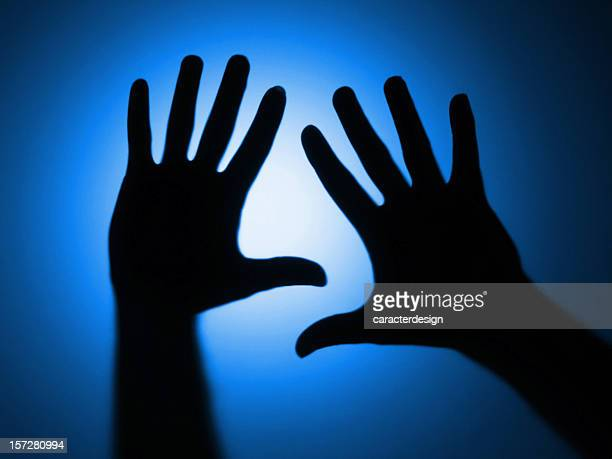 shadow: defocused hands blue - shadow puppet stock photos and pictures