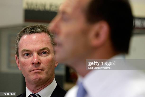 Shadow Education minister Christopher Pyne looks at Australian Opposition Leader Tony Abbott as he speaks to workers and the media at Penrice Soda...