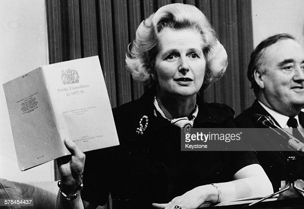 Shadow Environment Secretary Margaret Thatcher holding up a public expenditure booklet as she speaks at a Conservative Party press conference during...
