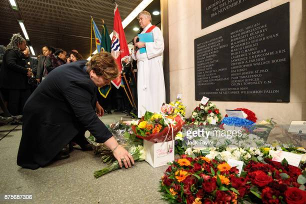 Shadow Foreign Secretary Emily Thornberry lays flowers during a memorial to mark the 30th anniversary of the King's Cross fire at King's Cross...